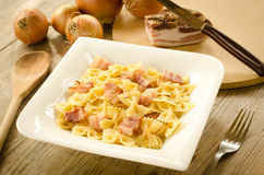 Farfalle with bacon Stock Photos