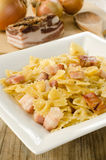 Farfalle with bacon Stock Photo