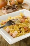 Farfalle with bacon Stock Photo