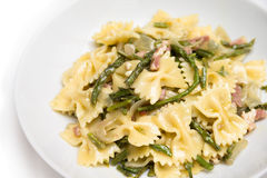 Farfalle with bacon and asparagus Royalty Free Stock Photography