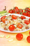 Farfalle with beans, bacon and cherry tomatoes stock photos