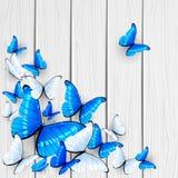 Farfalle blu su fondo di legno Fotografia Stock Libera da Diritti