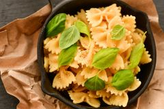 Farfalle. Close up of  Flavorful delicious   traditional italian meal pasta   farfalle with parmesan cheese   fresh basil and black pepper . Mediterranean food Stock Photo
