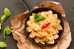 Farfalle. Close up of  Flavorful delicious   traditional italian meal pasta   farfalle with parmesan cheese   fresh basil and black pepper . Mediterranean food Stock Images