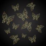 Farfalle dell'oro su un fondo nero Immagine Stock Libera da Diritti