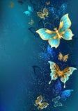 Farfalle dorate su un fondo blu Fotografia Stock Libera da Diritti