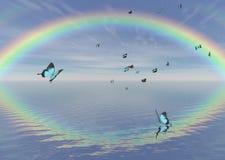 Farfalle e Rainbow blu del pavone Immagini Stock