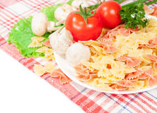 Farfalle with fresh tomatoes and mushrooms. Vegetarian food. farfalle with fresh tomatoes and mushrooms Royalty Free Stock Images