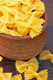 Farfalle italian pasta in wood bowl Stock Images