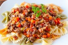 Farfalle pasta with bolognaise sauce Royalty Free Stock Photos