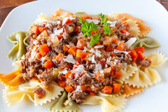 Farfalle pasta with bolognaise sauce Stock Photos