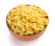 Farfalle pasta in bowl  on white Stock Photos