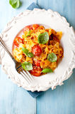 Farfalle pasta with cherry tomatoes and parmesan Stock Photo