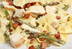 Farfalle Pasta with Chicken & Asparagus. Farfalle pasta meal with chicken, asparagus and pancetta in a cream sauce Stock Photo