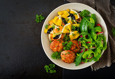 Farfalle pasta durum wheat with baked meatballs of chicken fillet in tomato sauce and salad Royalty Free Stock Photos