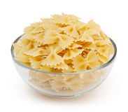 Farfalle pasta in glass bowl isolated on white Royalty Free Stock Images