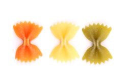 Farfalle pasta, isolated, three colors. Stock Photo