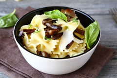Farfalle pasta with mushrooms and cheese Stock Photo