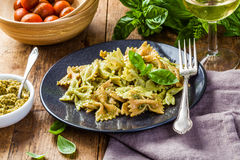 Farfalle pasta with pesto Stock Images