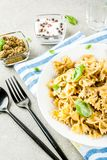 Farfalle pasta with pesto sauce Stock Photo