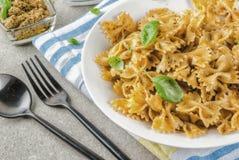Farfalle pasta with pesto sauce Stock Photos