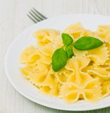 Farfalle pasta on plate Royalty Free Stock Photos