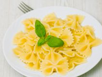 Farfalle pasta on plate Stock Images