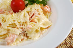 Farfalle pasta with salmon Stock Photo