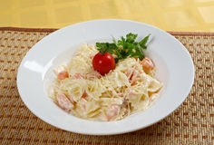 Farfalle pasta with salmon Royalty Free Stock Image