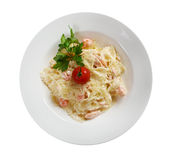 Farfalle pasta with salmon Stock Images