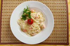 Farfalle pasta with salmon Stock Photos