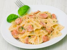 Farfalle pasta with sausage and cream sauce Stock Image