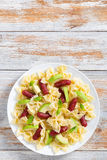 Farfalle Pasta warm salad with avocado slices and basil Stock Image