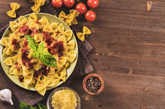 Farfalle pasta on wooden table with copy space. Italian farfalle pasta on wooden table top view with copy space Royalty Free Stock Images