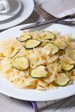 Farfalle pasta with zucchini closeup with knife and fork Royalty Free Stock Image