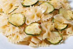 Farfalle pasta with zucchini slices macro horizontal Royalty Free Stock Photo