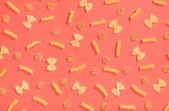 Farfalle, rotelle and fusilli pasta flat lay Stock Image