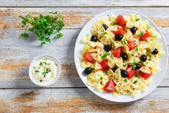 Farfalle with Smoked Salmon, black olives, view from above Royalty Free Stock Photo