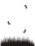 Farfalle sopra un campo illustrazione di stock