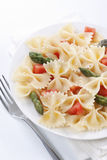 Farfalle, tomato and asparagus salad Stock Image