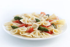 Farfalle, tomato and asparagus salad Stock Photos
