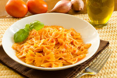 Farfalle with tomato sauce Stock Images