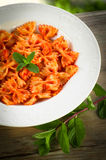 Farfalle with tomato and shrimps Stock Images