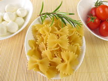 Farfalle, tomatoes and mozzarella balls Stock Image
