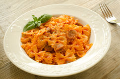 Farfalle topped with tomato sauce and meat Royalty Free Stock Photo