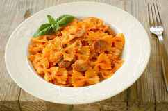 Farfalle topped with tomato sauce and meat Royalty Free Stock Photography