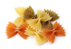 Farfalle tricolore pasta. Isolated on white background Stock Photos