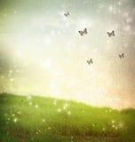 Farfalle in un paesaggio di fantasia Immagini Stock