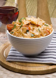 Farfalle and wine. Delicious farfalle pasta dish with wine Royalty Free Stock Images