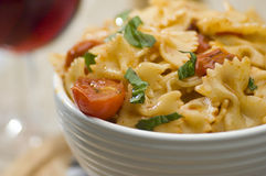 Farfalle and wine. Delicious farfalle pasta dish with wine Stock Photo